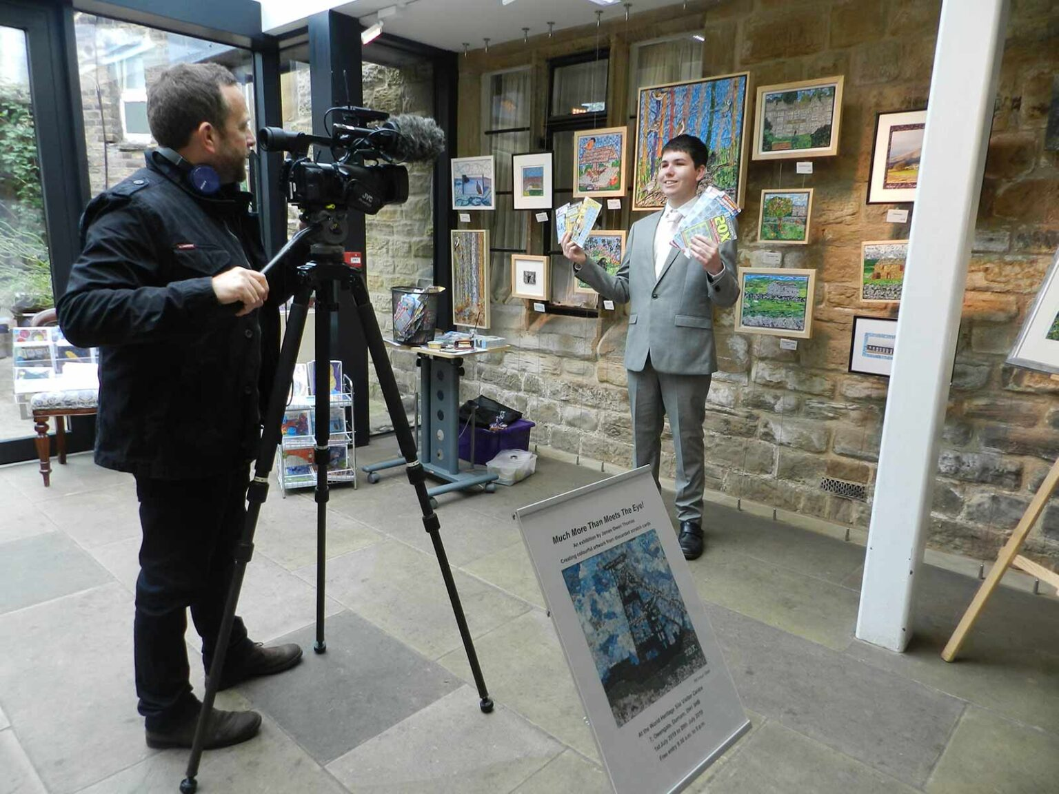 James being filmed for an interview at one of his exhibitions
